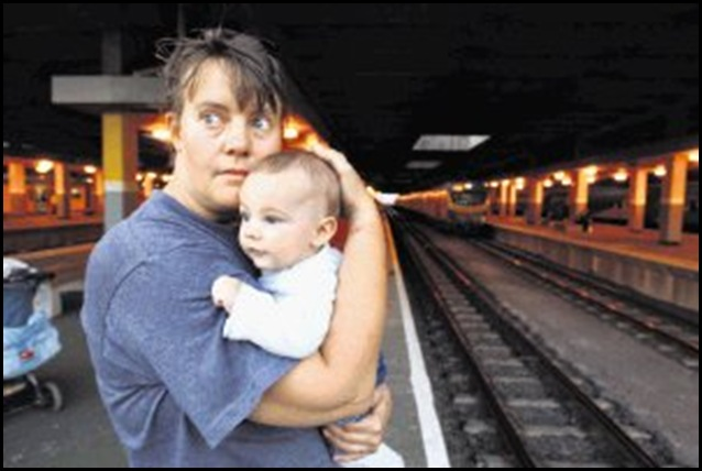 Helen Smith's wrist show cuts and bruises from being handcuffed with extreme force by a security guard at Durban train station when she was travelling from JHB to Toti withher mother and kids scene here after the incident with her 5 month old son Daniel Walker-Smith . Picture: JACKIE CLAUSEN 10/7/2009   ------  MAIN  25cm wide  fc