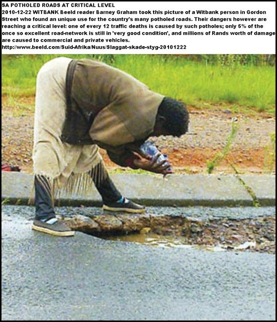 Washing laundry in Witbank POTHOLES Picture by Barney Graham Dec232010 BEELD