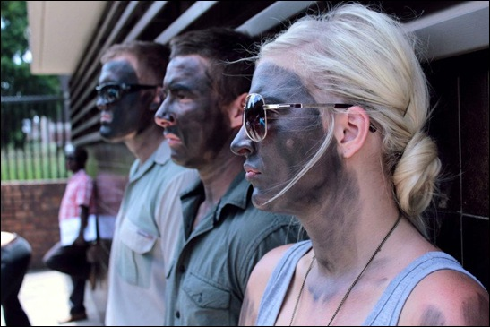 AFRIKAANS matriculants paint themselves black in protest against their top-performers being denied places at Afrikaans Universities for purely racist reasons