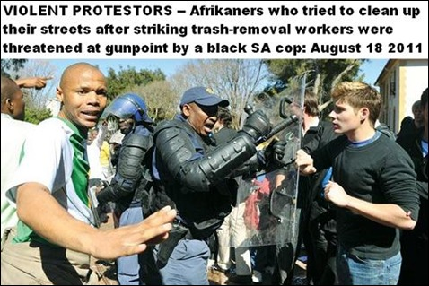 Afrikaners who tried to clean up after striking trash removal workers threatened at gunpoint by black SA cops Aug 18 2011