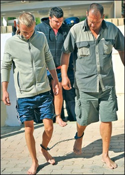 AFRIKANERS IN LAW COURTS CLAPPED IN CHAIN BAREFOOT HUMILATED